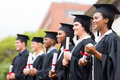 Group of university graduates multiracial at graduation ceremony Stock Photos