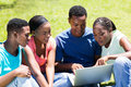 Group university students of african using laptop outdoors Royalty Free Stock Image