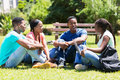 Group university students of cheerful african relaxing outdoors on campus Stock Images