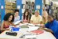 Group of university students working in library Royalty Free Stock Images