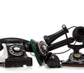 A group of vintage telephones on white Royalty Free Stock Images
