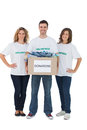 Group of volunteers holding donation box with clothes on white background Stock Photography