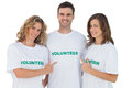 Group of volunteers pointing their tshirt on white background Stock Photo