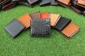 Group wallets of leather on grass Royalty Free Stock Image