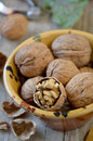 Group of walnuts in a ceramic bowl on a wooden background close up Royalty Free Stock Photos