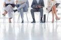 Group of well dressed business people waiting in room Royalty Free Stock Images