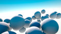 A group of white balls floating in the sky Royalty Free Stock Image