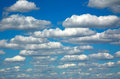 Group of white clouds on a blue sky background Royalty Free Stock Photo