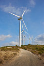 Group of windmills for renewable electric energy production on blue sky Royalty Free Stock Photography