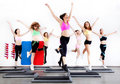 Group of women doing aerobics on stepper Royalty Free Stock Photos