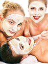 Group women with facial mask woman getting and gossip isolated Stock Image