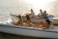 Group of women and men navigating motorboats summer lake Stock Images