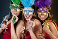 Group of women partying beautiful three having fun during party on dark background Stock Photo