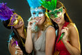 Group of women partying beautiful three having fun during party on dark background Stock Images