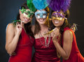 Group of women partying beautiful three having fun during party on dark background Stock Photography