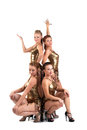 Group of women posing in gold costume Stock Photography