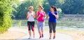 Group of women running at lakeside jogging Royalty Free Stock Photo