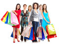 Group of women with shopping bags isolated over white background Royalty Free Stock Photography