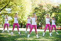 Group of women stretching to warm up at the park Royalty Free Stock Photography
