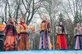 The group of women wearing traditional Russian clothers sing a song on Maslenitsa in Moscow. Royalty Free Stock Photo