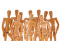 Group of wooden dummies Royalty Free Stock Photo