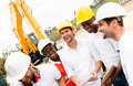 Group of workers at a building site happy laughing Royalty Free Stock Photos