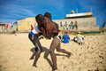 Group of wrestlers training on the beach in senegal saint louis december unidentified senegalese wrestling is a type folk Stock Image