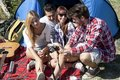 Group of young adult watching photos on digital camera Royalty Free Stock Photo