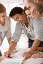 Group of young business people working on a project in office Royalty Free Stock Image