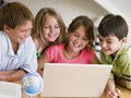 Group Of Young Children Doing Their Homework Stock Photography