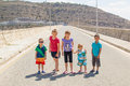 Group of young children fun standing on the emty road Royalty Free Stock Images