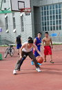 A group of young chinese men playing basketball on a court at the city stadium in pengzhou china Stock Photo