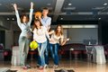Group of young friends playing bowling spending time with friends Royalty Free Stock Images