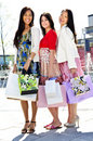Group of young girlfriends shopping Stock Photo