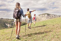 Group of young hikers in the mountain in single file Royalty Free Stock Photo