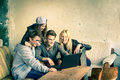Group of young hipster best friends with computer laptop in urban alternative location concept friendship and fun new Royalty Free Stock Photo