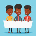 Group of young men holding white blank board. Royalty Free Stock Photo