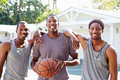 Group Of Young Men Playing Basketball Match Royalty Free Stock Photo