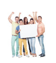 Group of young people with a blank poster isolated on white background Royalty Free Stock Images