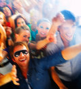 A group of young people enjoying a concert Royalty Free Stock Image