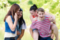 Group of young people friends happy outdoors portrait teenage smiling looking at camera having fun Royalty Free Stock Image