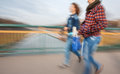 A group of young people going along the street intentional motion blur Royalty Free Stock Images