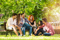Group of young people having fun outdoors Royalty Free Stock Photo
