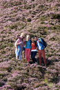 Group Of Young People Hiking Through Countryside Royalty Free Stock Photo