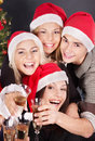 Group young people in santa hat at nightclub. Royalty Free Stock Image