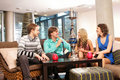 A group of young people smoking hookah in a cafe Royalty Free Stock Image