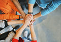 Group of young people stacking their hands top view image putting together friends with stack showing unity Royalty Free Stock Photo