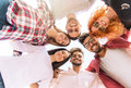 Group of young people standing in a circle, outdoors Royalty Free Stock Photo
