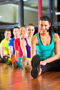 Group young people stretching gym better fitness led instructor Royalty Free Stock Image
