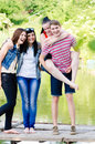 Group of young people teenage friends outdoors happy smiling looking at camera having fun Royalty Free Stock Image